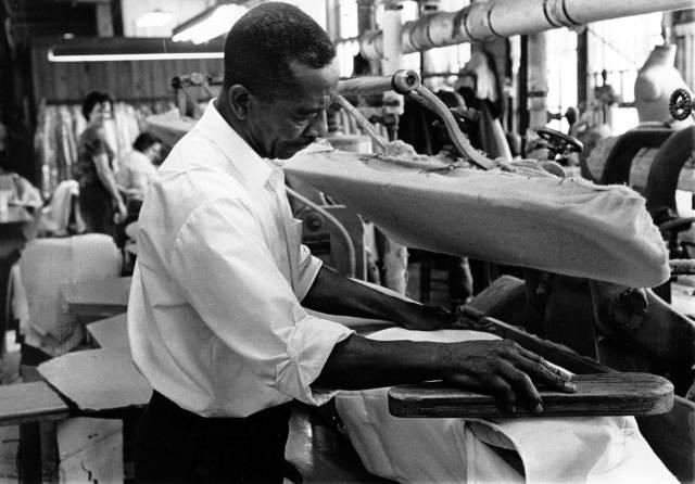man pressing garment milledgeville